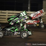 Kraig Kinser (#11K) racing with Jason Sides (#7S) Friday at Knoxville Raceway. (Mark Funderburk Photo)