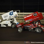 Wayne Johnson (#2) and Jeff Swindell (#47) racing for position during Saturday's feature at Knoxville Raceway. (Mark Funderburk Photo)