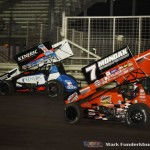 Kerry Madsen (#1AUS) racing with Paul McMahan (#7) Friday at Knoxville Raceway. (Mark Funderburk Photo)