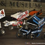 Ian Madsen (#18), Jason Sides (#7S), and James McFadden (#3) racing for position around Danny Smith (#4) Friday during the SPEED SPORT World Challenge at Knoxville Raceway. (Mark Funderburk Photo)