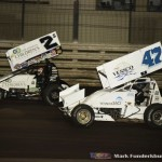 Shane Stewart (#2) drives by Jeff Swindell for the lead Wednesday night at Knoxville Raceway. (Mark Funderburk Photo)