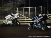 Shane Stewart (#2) racing with Donny Schatz (#15) for the lead Wednsday night at Knoxville Raceway. (Mark Funderburk Photo)