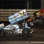 Terry McCarl (#7x) racing with Jason Johnson (#41) at Knoxville Raceway. (Mark Funderburk Photo)