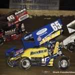 Brent Marks (#19), Jordan Goldesberry (#65), and Hunter Schuerenberg (#20) racing for position Saturday night at Federated Auto Parts Raceway at I-55. (Mark Funderburk Photo)