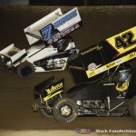 Paul McMahan (#7) racing with Andy McElhannon (#42) Saturday night at Federated Auto Parts Raceway at I-55. (Mark Funderburk Photo)