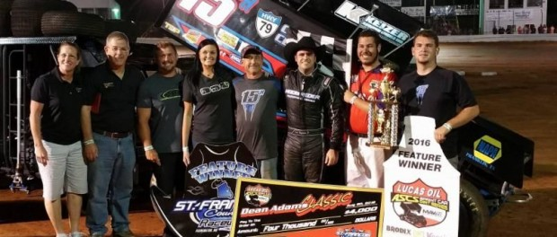 Sam Hafertepe Jr. with his team in victory lane following his victory at St. Francois County Raceway. (ASCS / Terry Ford Photo)