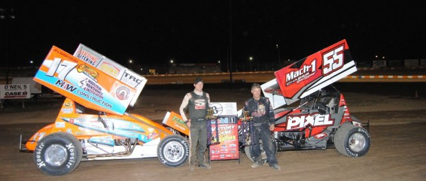 Jared Hostman (left) and Mark Smith (right) in victory lane following their victories in the Twin-15's at Ohsweken Speedway. (T.J. Buffenbarger Photo)