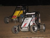 #85 Shane Hollingsworth battles with #1 Scott Hatton during the 20 lap midget feature event. (Bill Miller Photo)
