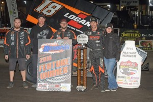Ian Madsen with his team in victory lane following their victory Friday at Jackson Motorplex. (ASCS / Rob Kocak Photo)