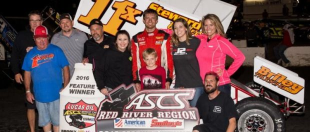 John Carney with his family and crew following his victory Saturday night at Devil's Bowl Speedway. (Pat Grant Photo)