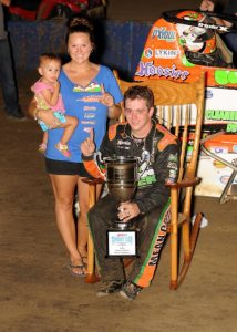 "Brady Bacon celebrates his ""Indiana Sprint Week"" title with his wife and daughter in July 2016 at the Terre Haute (Ind.) Action Track. (David Nearpass Photo)"