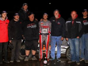 Tanner Thorson (middle) and the Keith Kunz/Curb-Agajanian Motorsports crew celebrate their 2016 USAC National Midget title. (Rich Forman Photo)
