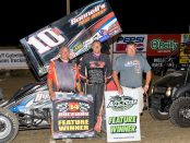 Chad Kemenah [center] in 34 (IL) Raceway victory lane. (Vince Vellella photo)