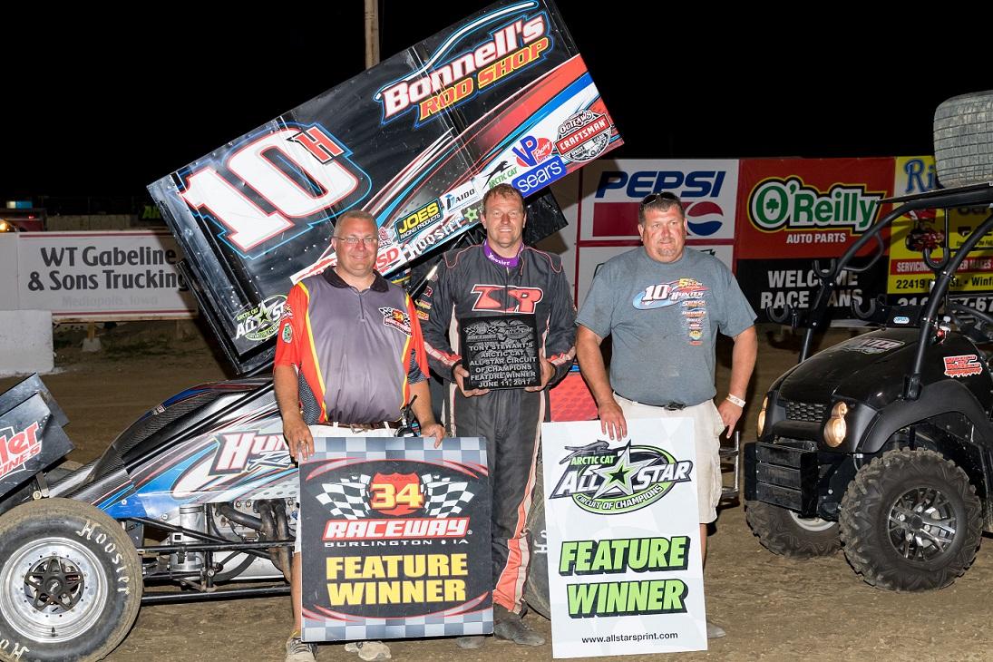 Chad Kemenah [center] in 34 (IL) Raceway victory lane. (Vince Vellella photo)