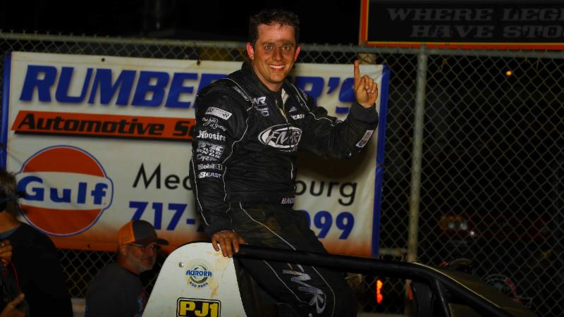 Brady Bacon shows the wears in victory lane after his first career USAC Silver Crown victory Friday night at Williams Grove