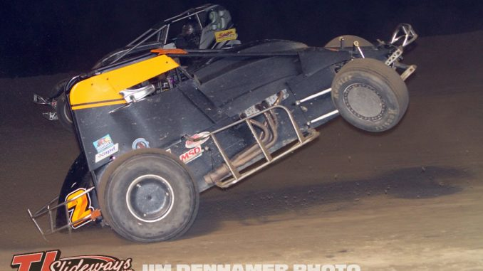 Mike Galajda's car with the front wheels up after spinning at I-96 Speedway. (Jim Denhamer Photo)